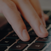 Closeup of person typing on keyboard