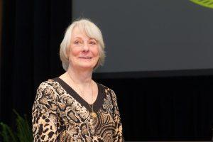 President Nathan O. Hatch awards the Medallion of Merit to art professor Peggy Smith.