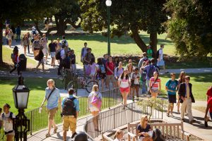 Wake Forest students walk across Manchester Plaza on their way to class.