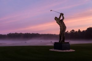 A statue of golf legend Arnold Palmer stands outside the Arnold Palmer Golf Complex on the campus of Wake Forest University on Tuesday, October 15, 2013.