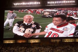 Honorary Wake Forest captain Arnold Palmer meets Louisville captain Muhammad Ali. [Orange Bowl coverage by the Wake Forest University Office of Creative Services. Use of game action and player photos is restricted by the NCAA and the Orange Bowl.]