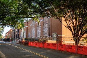 orange construction fencing as the Reynolds Gym renovation happens