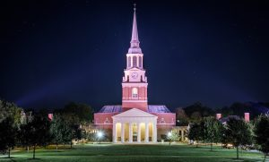 The bell tower of Wait Chapel rises above the Wake Forest campus early on the morning of Wednesday, October 18, 2017.