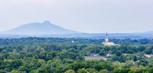 An aerial view of Wait Chapel with Pilot Mountain in the distance, shot from the Nissen building in downtown Winston-Salem.