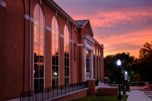 The sunrise reflects in the windows of Reynolds Gym, on the campus of Wake Forest University, Wednesday, November 1, 2017.