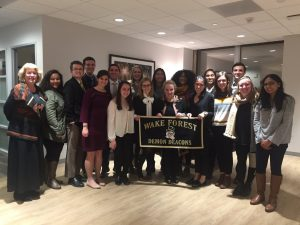 The Wake Washington Students and Dr. Harriger pose for a photo with former-Secretary of State Madeline Albright