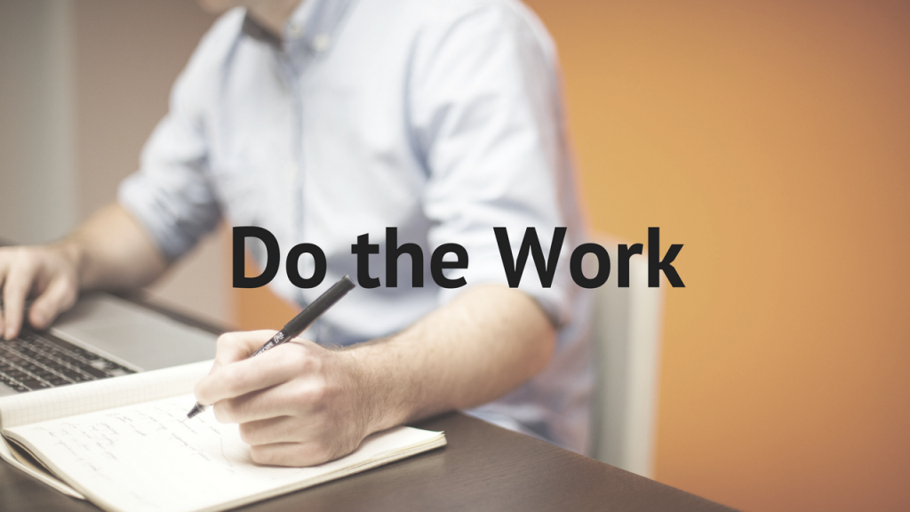 Do the Work, photo of man writing at a desk