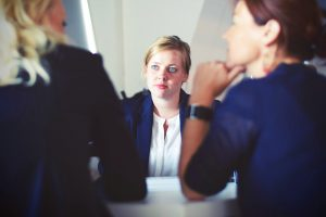 Female employee talking to other colleagues