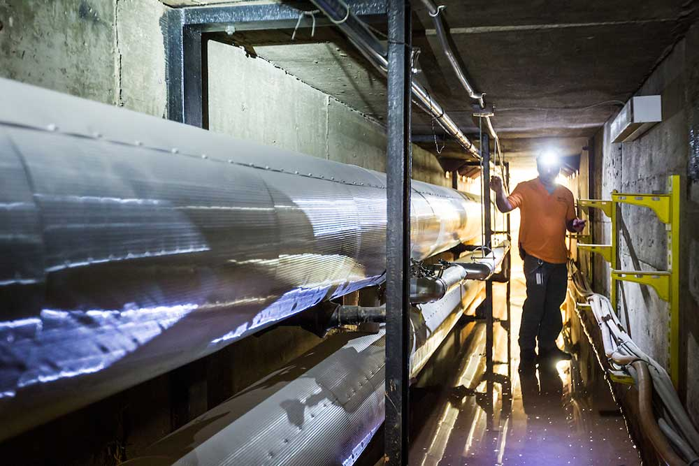 Wake Forest Environmental Health and Safety employee Justin Sizemore checks air quality in the steam tunnel