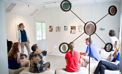 Paul Bright, assistant director of the Charlotte and Philip Hanes Art Gallery, leads a critique during his summer-session course on collage at the Student Art Gallery in Reynolda Village.