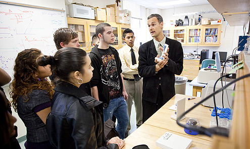 Professor Jed Macosko gives a tour of his lab in Olin Physical Laboratory to students from Atkins Academic and Technology High School.