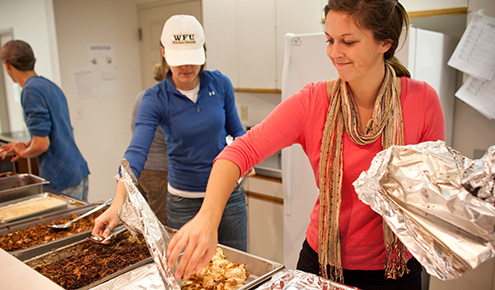As part of Campus Kitchen's Turkeypalooza, student volunteers deliver dinner to and spend time with young people at The Children's Home in Winston-Salem.