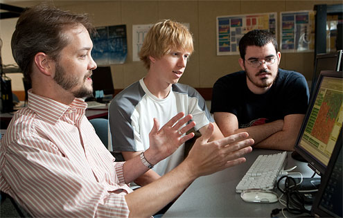 Computer science professor Errin Fulp works with graduate students Brian Williams (center) and Wes Featherstun (far right), who worked this summer at Pacific Northwest National Laboratory developing a new type of computer network security software modeled after ants.