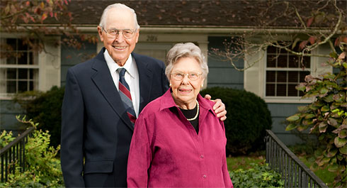 Henry and Elizabeth Stroupe in front of their Faculty Drive home in 2006.