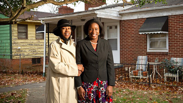 Law student Ashleigh Wilson ('11), right, stands with homeowner Tonya Williams.