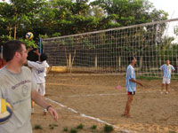 Students play soccer with locals in Vietnam village.