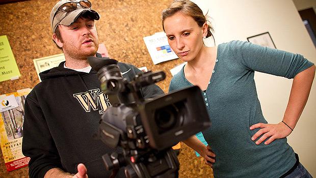 Documentary film program students Sam Smartt (BA '09) and Hillary Pierce work on a short film promoting recycling.