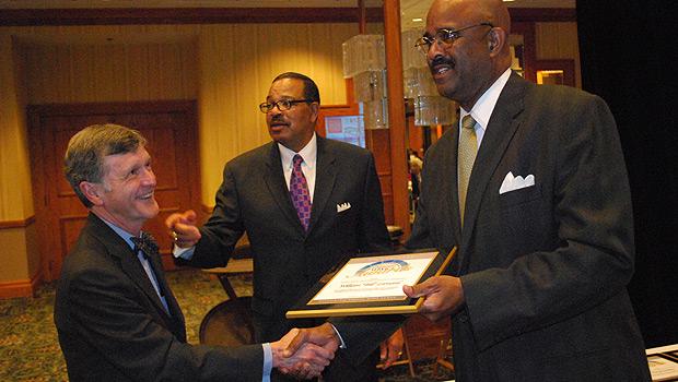 Bill Leonard (left) accepts his award. (Photo courtesy Winston-Salem Chronicle)