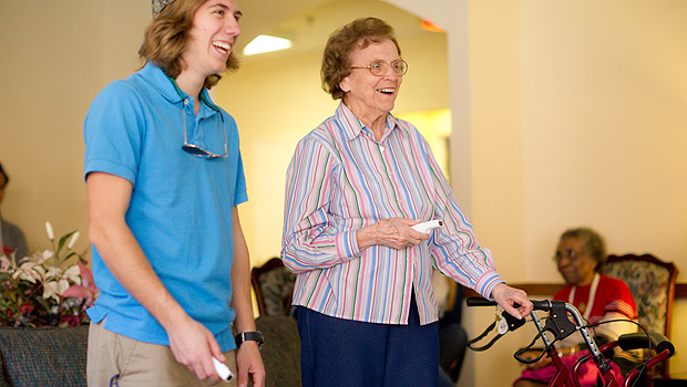 Sophomore Michael Scott competes against resident Joan Stewart in Wii Bowling at Independence Village, a retirement community in Winston-Salem.