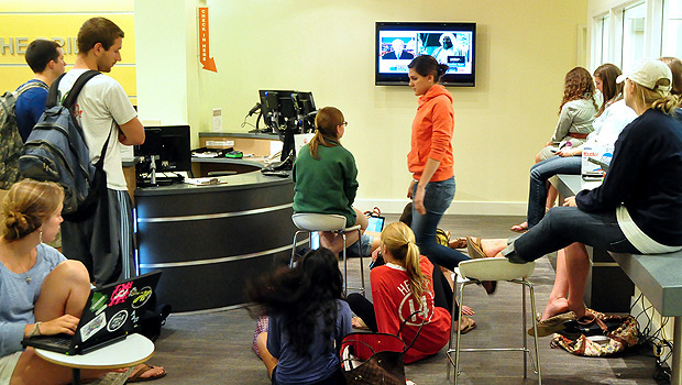 Students watch coverage of Osama bin Laden's death on a television in the Z. Smith Reynolds Library.