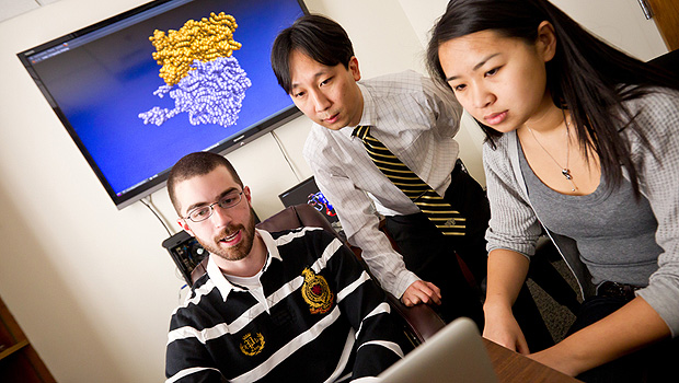 Computer science and physics professor Samuel Cho (center) works with his students, graduate student Tyson Lipscomb (left) and senior Anqi Zou ('12).