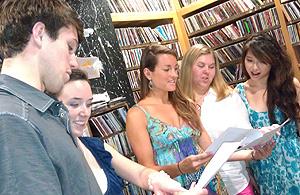 Students perform the radio play.