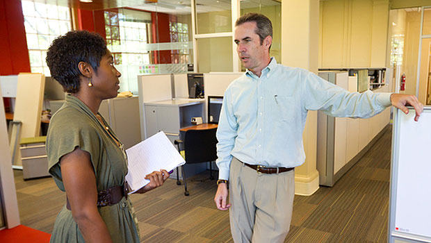 Patrick Sullivan (right), the assistant director of career education and counseling, talks with a student in the OPCD office.