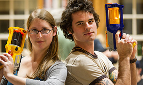 Two students hold their Nerf guns