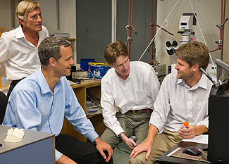 From left: NanoMedica CEO Roger Cubicciotti and Wake Forest physics professors Jed Macosko, Keith Bonin and Martin Guthold in a lab in Olin Hall.