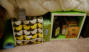 Items under the bed in a green dorm room