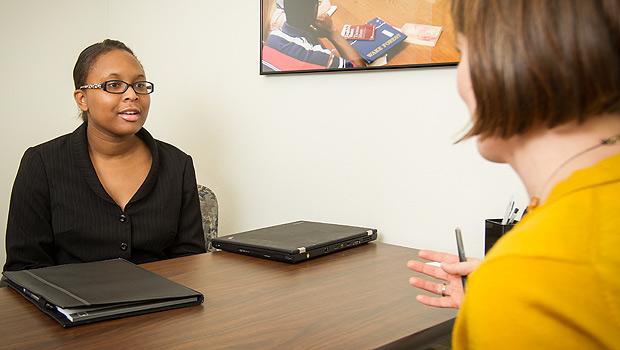 News director Katie Neal ('03) interviews senior philosophy major Marika Dillard ('13).
