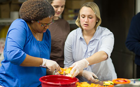 Students prepare meals for Turkeypalooza.
