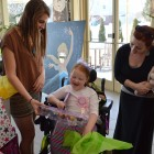 Pocahontas (Wake Forest student Lydia Pappas) talks with Ava Elsner and her mother at the Make-A-Wish event on campus. Photo credit: Cameron Miller.