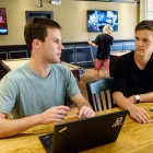 Junior John Marbach and senior Nikolai Hlebowitsh chat about their experiences in the tech industry in Zick's pizza joint on campus.
