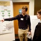 Junior Pierre Duncan explains his chemistry research project.