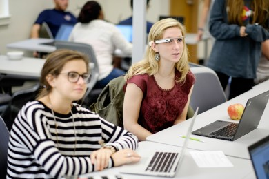 Allie Chambers ('17), right, gives Google Glass a go.