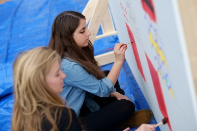 Andrea Becker ('16), in blue, and Marlee Stark ('17), in black, work on their panels.