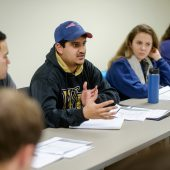Wake Forest senior political science majors discuss education policy in Katy Harriger's seminar class in Kirby Hall on Thursday, January 21, 2016. Karan Bakshi ('16) makes a point during the discussion.