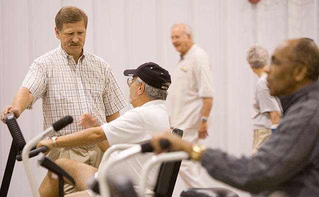 Professor of Health and Exercise Science researcher Jack Rejeski talks with research subjects.