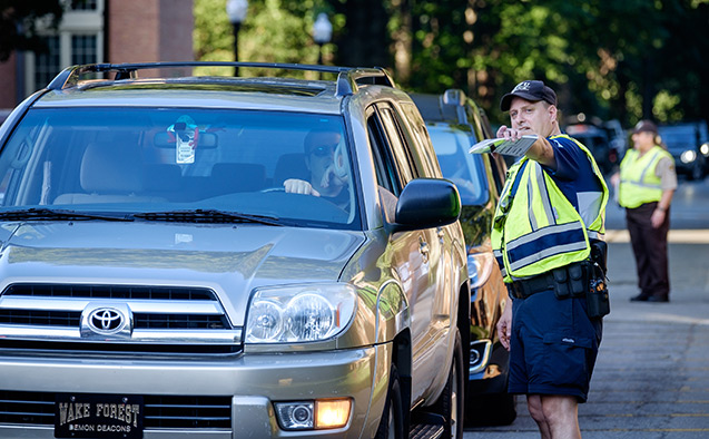 WFU police guide traffic on move-in day.