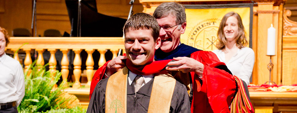 Carroll receives his masters hood from Bill Leonard in 2013 [photo by Arthur Cameron Photography]