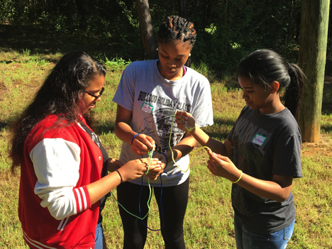College LAUNCH students work together on a string puzzle.