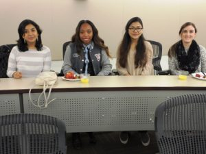 Four students smile at the camera during a College LAUNCH session.