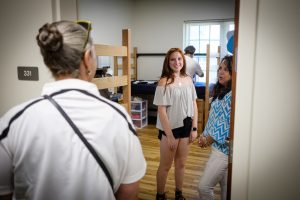 Students talk to Vice President Penny Rue during Move-In