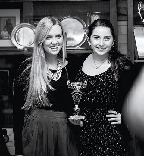 Maddie Langr (left) and Erica Duff with one of many debate team trophies won through the years.