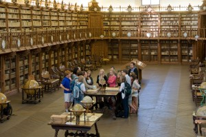 Students and their resident professor, Javier Garcia Garrado, in the Old Library at the University of Salamanca.