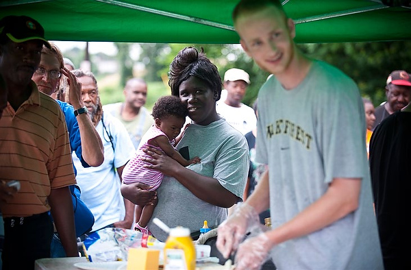 Junior George Aldhizer serves sandwiches to homeless during Wake Saturdays