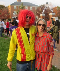 Associate Dean for Campus Life Mike Ford ('72) welcomes Libby Bell ('93) back to campus for the 25th annual Project Pumpkin.