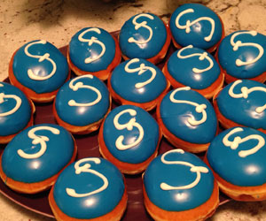 Refreshments included platters of custom donuts iced with the Strings insignia.