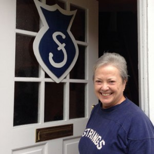 Donna Boswell ('72, WFU Trustee) greets guests at her home with a replica of the signs that generations of Strings nailed to their dorm room doors.